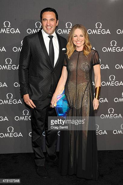 Interior designers Javier Loya and Lucinda Loya attend the OMEGA Speedmaster Houston Event at Western Airways Airport Hangar on May 12 2015 in Sugar...