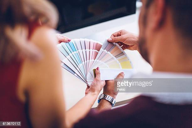 interior designers pointing at color charts - design studio stock pictures, royalty-free photos & images