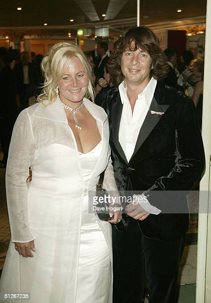 Interior designer/TV presenter Laurence LlewelynBowen and his wife Jackie arrive at the TV Quick Awards 2004 at The Dorchester on September 6 2004 in...