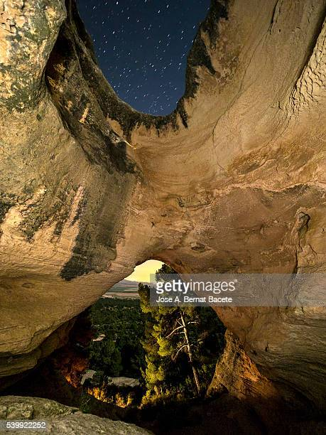 "Interior during the night  of the cave,  Cueva Horadada, "" The Perforated one "" placed in the mount Arabí. Heritage of the humanity. UNESCO"