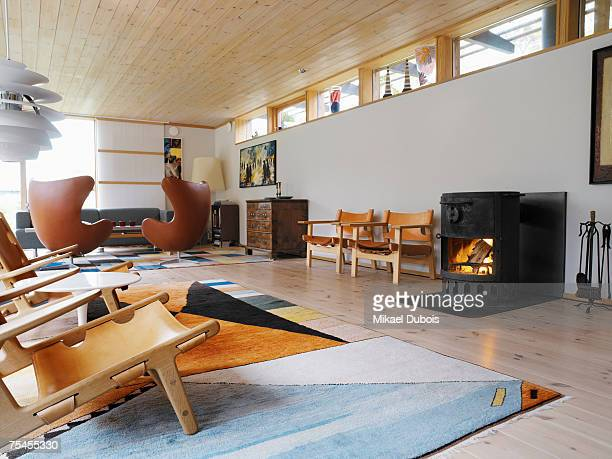 Interior from a designed living room with a fireplace.