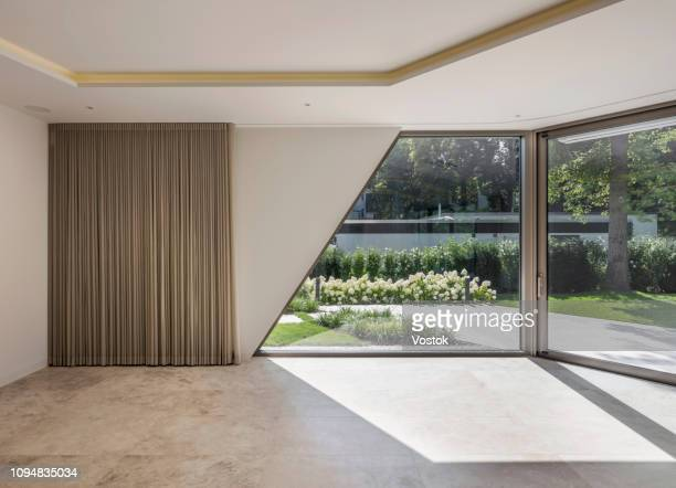interior in a modern villa in berlin - patio doors stock pictures, royalty-free photos & images