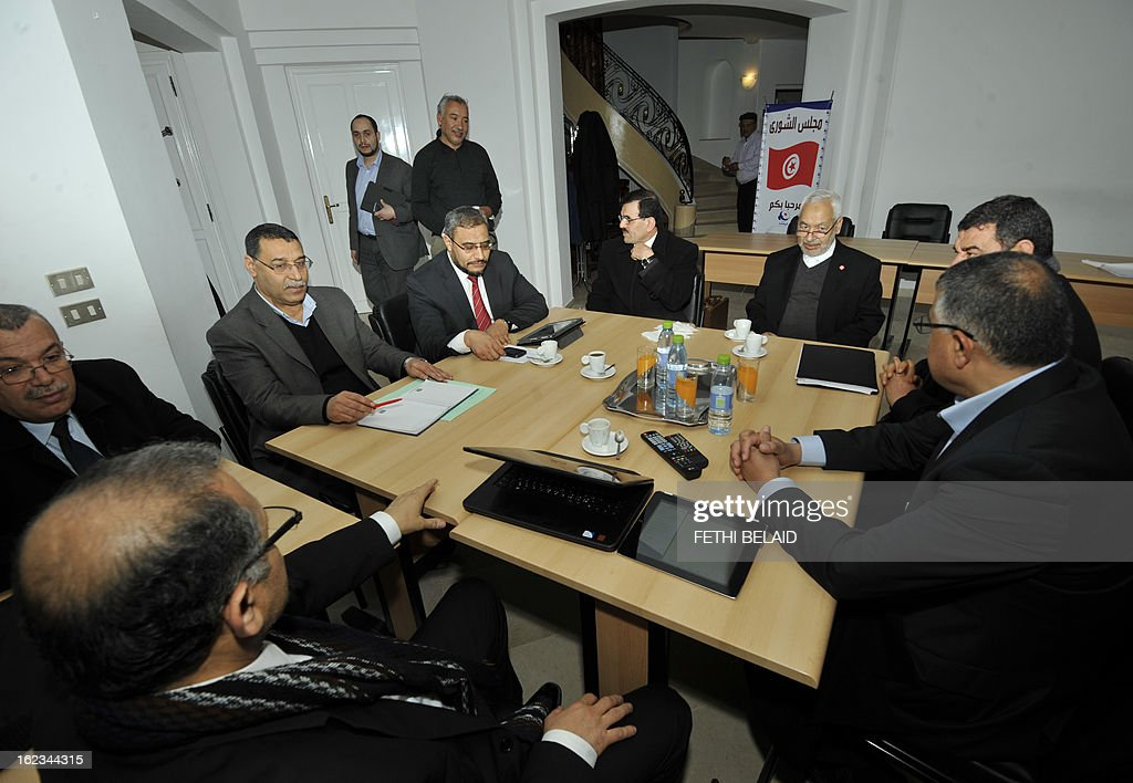 Interior Minister Ali Larayedh (C) sits near Ennahda ruling party's leader Rached Ghannouchi (2ndR) before a meeting at the party's headquarters on February 22, 2013 in Tunis. Ennahda has tapped Larayedh as its candidate to replace Prime Minister Hamadi Jebali, who resigned this week amid a major political crisis, the party said.