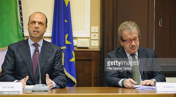 Interior Minister Angelino Alfano and Governor of Lombardy Roberto Maroni attend a meeting on safety after a recent spate of violence in Milan at...
