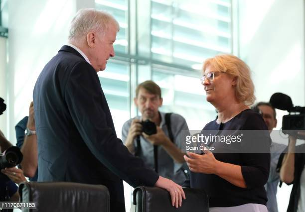 Interior Minister Horst Seehofer and Justice Minister Christine Lambrecht chat prior to the weekly government cabinet meeting on August 28 2019 in...