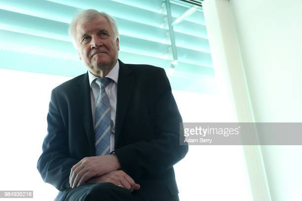 Interior Minister Horst Seehofer arrives for the weekly German federal Cabinet meeting on June 27 2018 in Berlin Germany High on the meeting's agenda...