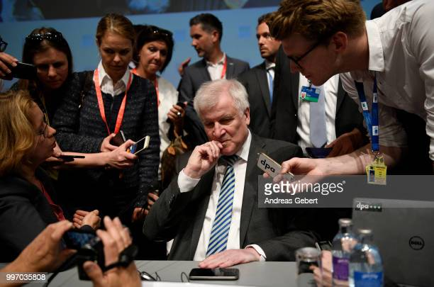 Interior Minister Horst Seehofer of Germany speaks with media representatives after a press conference during the European Union member states'...