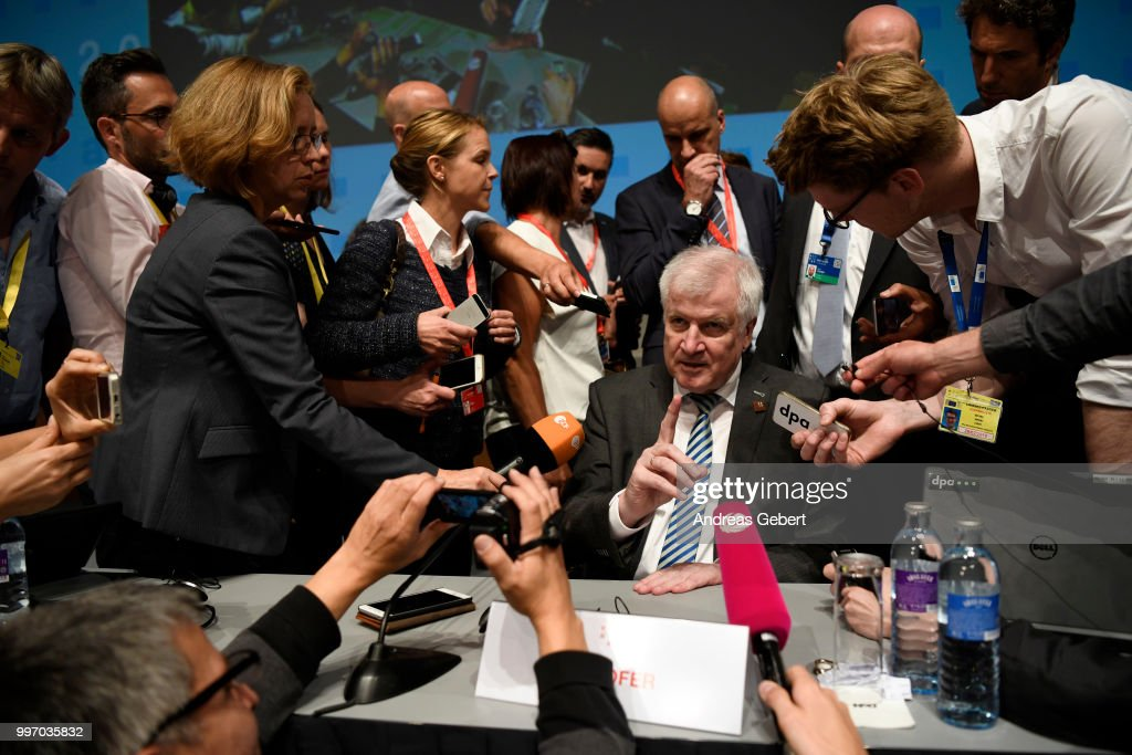 Interior Minister Horst Seehofer of Germany speaks with media representatives after a press conference during the European Union member states' interior and justice ministers conference on July 12, 2018 in Innsbruck, Austria. The meeting is taking place among mounting efforts by governments across Europe to restrict the entry of migrants and refugees.
