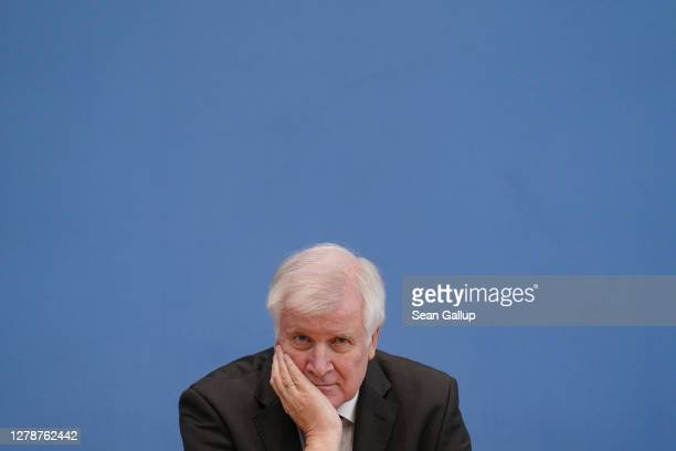 Interior Minister Horst Seehofer speaks to the media to present a report on political extremism among members of Germany's security and law...