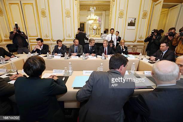 Interior Minister Manuel Valls Sports Minister Valerie Fourneyron Paris SaintGermain football club's general director JeanClaude Blanc and LFP...