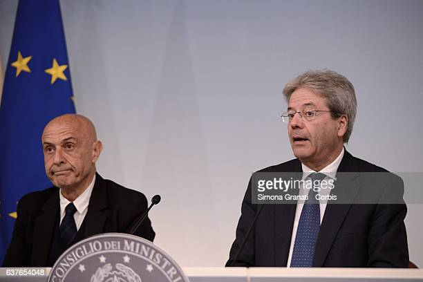 Interior Minister Marco Minniti the prime minister Paolo Gentiloni participate in the press conference at Palazzo Chigi after the meeting with the...