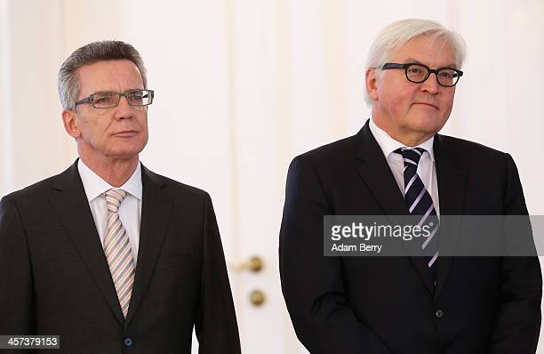 Interior Minister Thomas de Maiziere and Foreign Minister Frank-Walter Steinmeier attend a ceremony in which German President Joachim Gauck appointed...