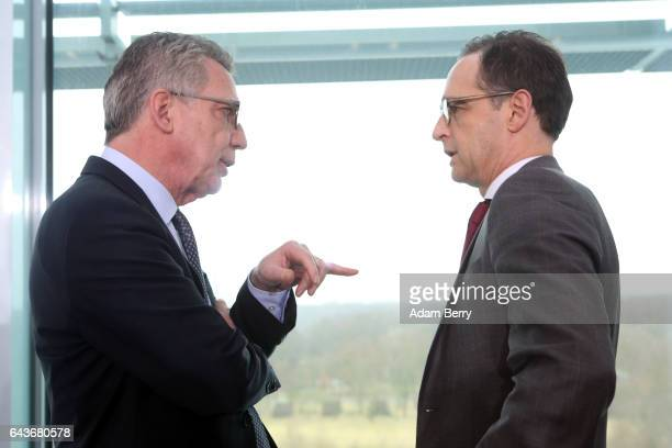 Interior Minister Thomas de Maiziere speaks to Justice Minister Heiko Maas as they arrive for the weekly German federal Cabinet meeting on February...