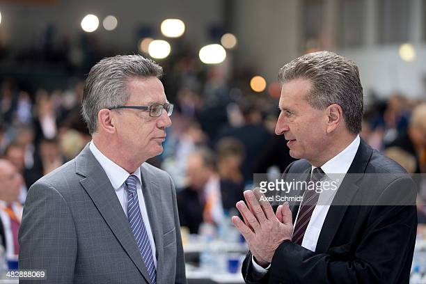 Interior Minister Thomas de Maiziere talks with European Energy Commissioner Guenther Oettinger at the CDU federal congress on April 5 2014 in Berlin...