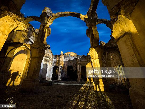 interior of a abandoned convent, in ruins and without i roof in the moonlight - flying buttress stock photos and pictures