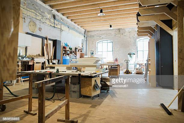 interior of a carpenter's workshop - werkstatt stock-fotos und bilder