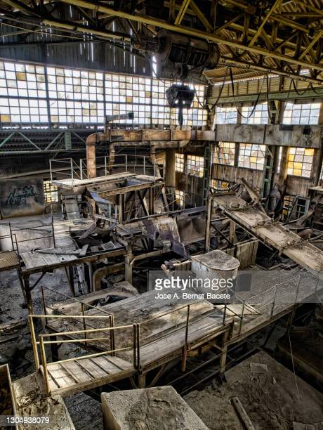 interior of a factory for the treatment and washing of materials in a mine with old machinery. - absence stock pictures, royalty-free photos & images