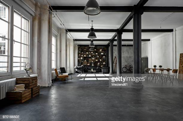 interior of a loft flat - design foto e immagini stock