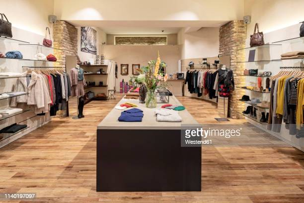interior of a modern concept store, displaying fashion - clothing store stock pictures, royalty-free photos & images