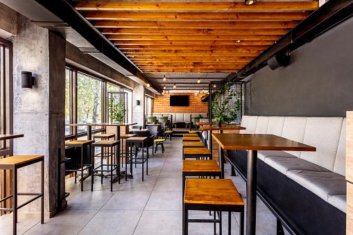 Interior of a modern industrial design pub 1085224420