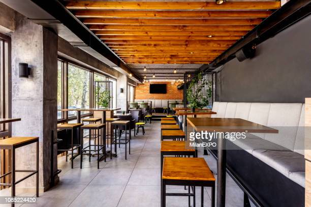 interior of a modern industrial design pub - pub stock pictures, royalty-free photos & images
