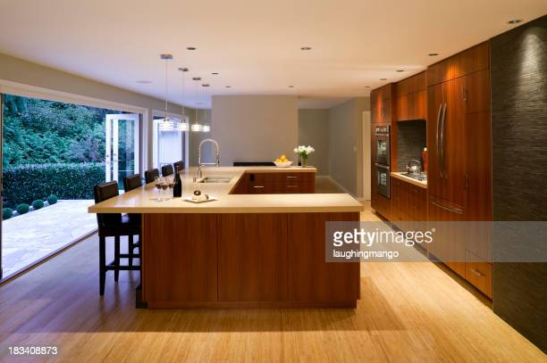 Interior of a modern kitchen constructed mostly of wood