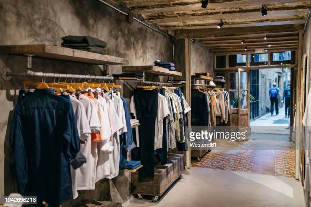 interior of a modern menswear shop - store stock pictures, royalty-free photos & images