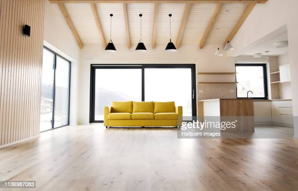 interior of a modern white empty kitchen and living room. - no people stock pictures, royalty-free photos & images