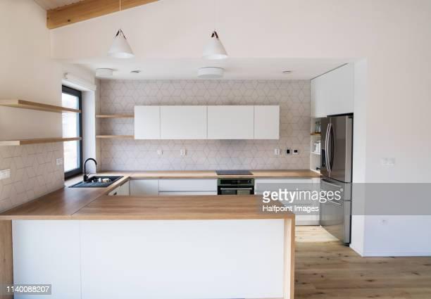 interior of a modern white empty kitchen. - privatküche stock-fotos und bilder