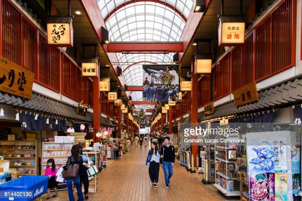 interior of a new shopping mall, asakusa sisterogon street in asakusa district, tokyo. this mall is one of kind in japan with a traditional wooden floor. - ショッピングエリア ストックフォトと画像