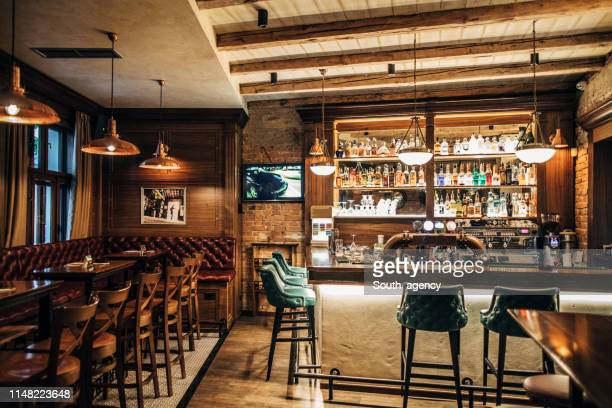 interior of a pub - pub stock pictures, royalty-free photos & images