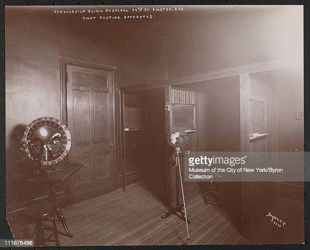 Interior of a room with sight testing apparatus at the Vanderbilt Clinic at 59th Street and Amsterdam Avenue, New York, New York, late 1890s.