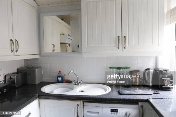 interior of a small kitchen - domestic kitchen stock pictures, royalty-free photos & images