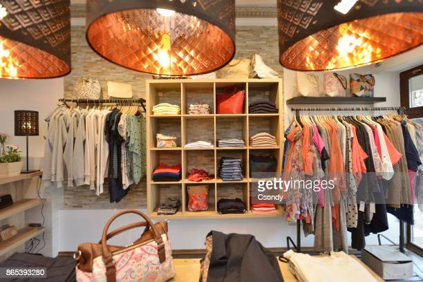 interior of a store selling women's clothes and accessories - fashion showroom stock pictures, royalty-free photos & images