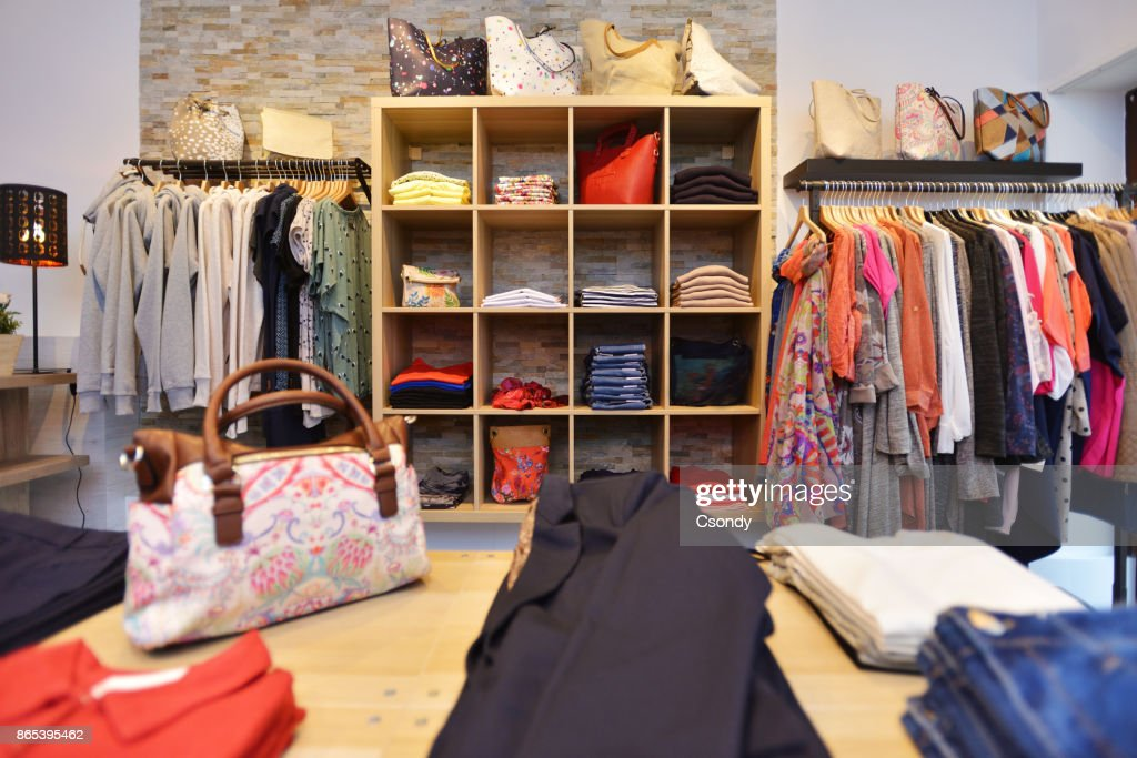 23a6962591f Interior of a store selling women s clothes and accessories   Stock Photo