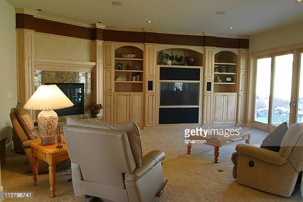 interior of a stylish furnished living room - reclining chair stock photos and pictures