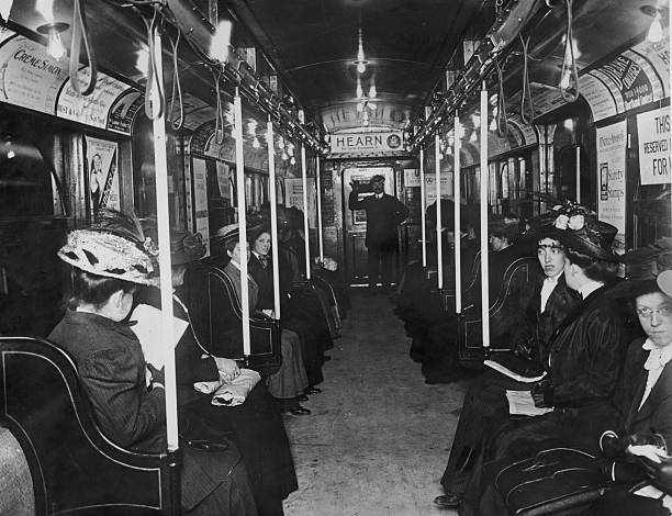 Interior of a subway car with female passengers and...