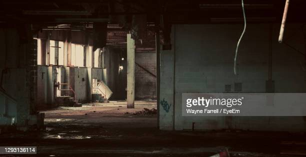 interior of abandoned building - damaged stock pictures, royalty-free photos & images