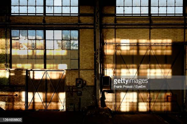 interior of abandoned building windows illuminated by evening sunlight - esch sur alzette stock pictures, royalty-free photos & images