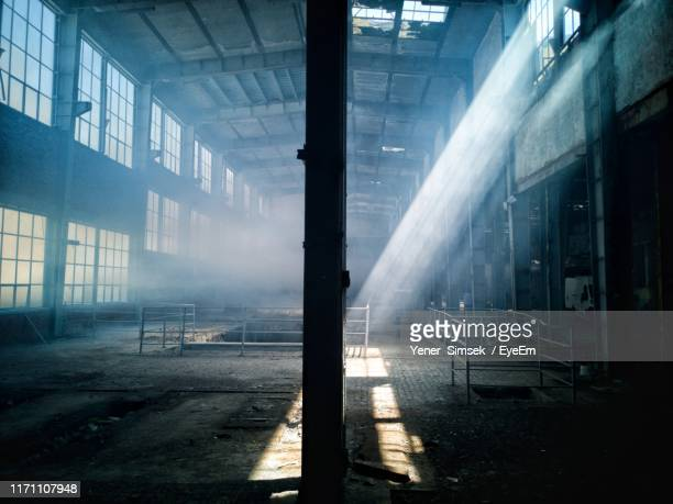 interior of abandoned factory - abandoned stock pictures, royalty-free photos & images