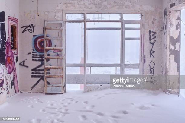 Interior Of Abandoned House covered with snow