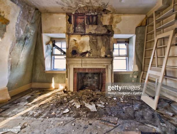 interior of abandoned mansion - bad condition stock pictures, royalty-free photos & images