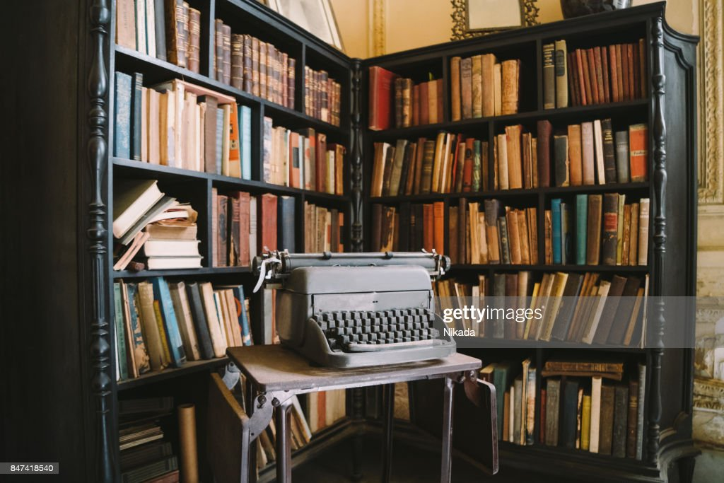 Interior of abandoned ornate Colonial Villa with books and typewriter : Stock Photo