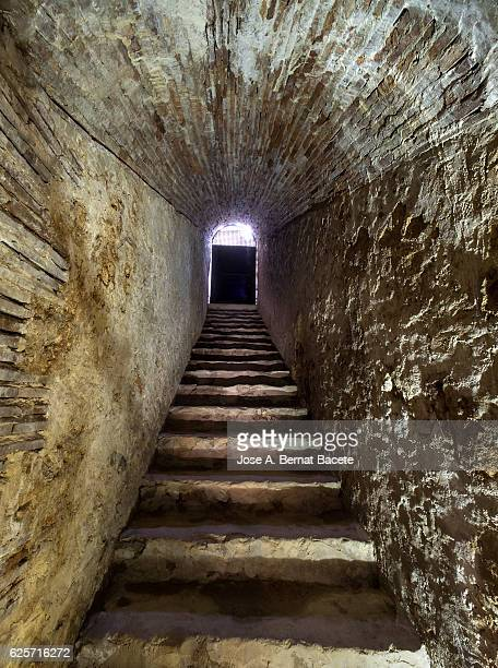 interior of an ancient house constructed between the rock with a stairs of access on the outside. - claustrophobia stock photos and pictures