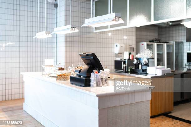 interior of an empty coffee shop - checkout stock pictures, royalty-free photos & images