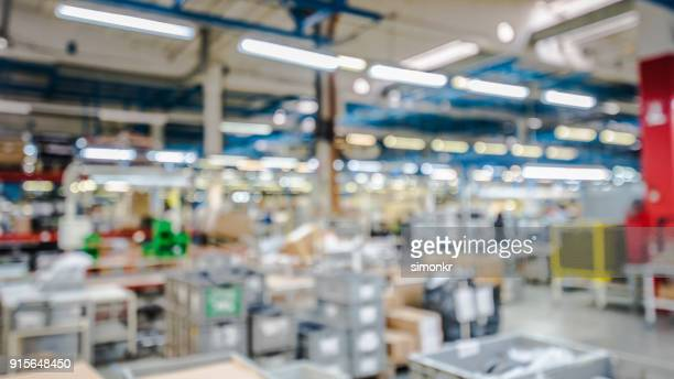 interior of appliance manufacturing factory - soft focus foto e immagini stock
