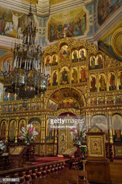 Interior of Ascension Cathedral in Almaty Kazakhstan with gold leaf iconostasis wall to the sanctuary