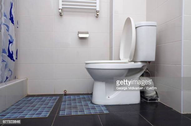 interior of bathroom - toilet bowl stock photos and pictures