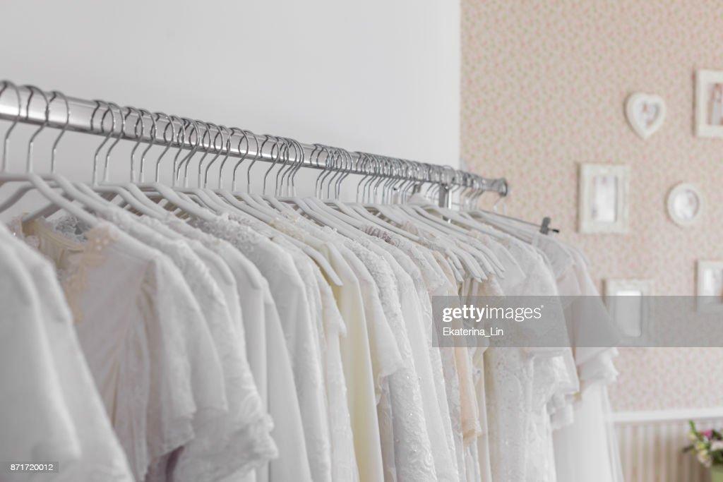 Interior Of Bridal Salon Beautiful Wedding Dress On A Hangers Stock ...