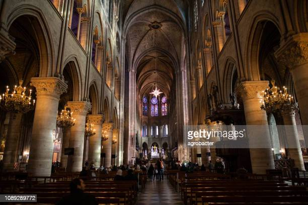 interior of cathedrale notre dame, medieval catholic cathedral - notre dame de paris stock photos and pictures